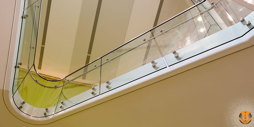 Best Curved Glass Button Railing St Edwards University 400 x 300