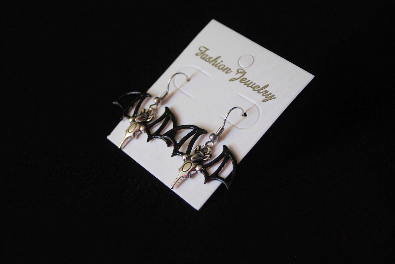Flying bat earrings womens black and silvertone dangle earrings