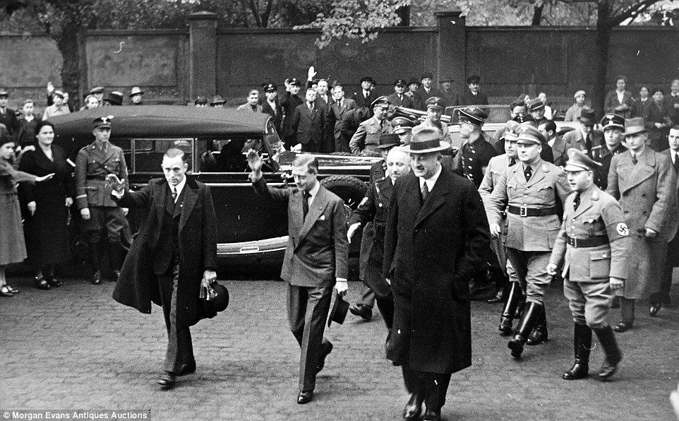Queen Elizabeth II's uncle, the Duke of Windsor, who abdicated the previous year, is pictured making the distinctive 'Heil Hitler' sign while surrounded by uniformed high-ranking fascists on an unofficial visit to Germany in 1937.