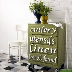 What a cute idea to store these kitchen items. I love that it is painted green too!