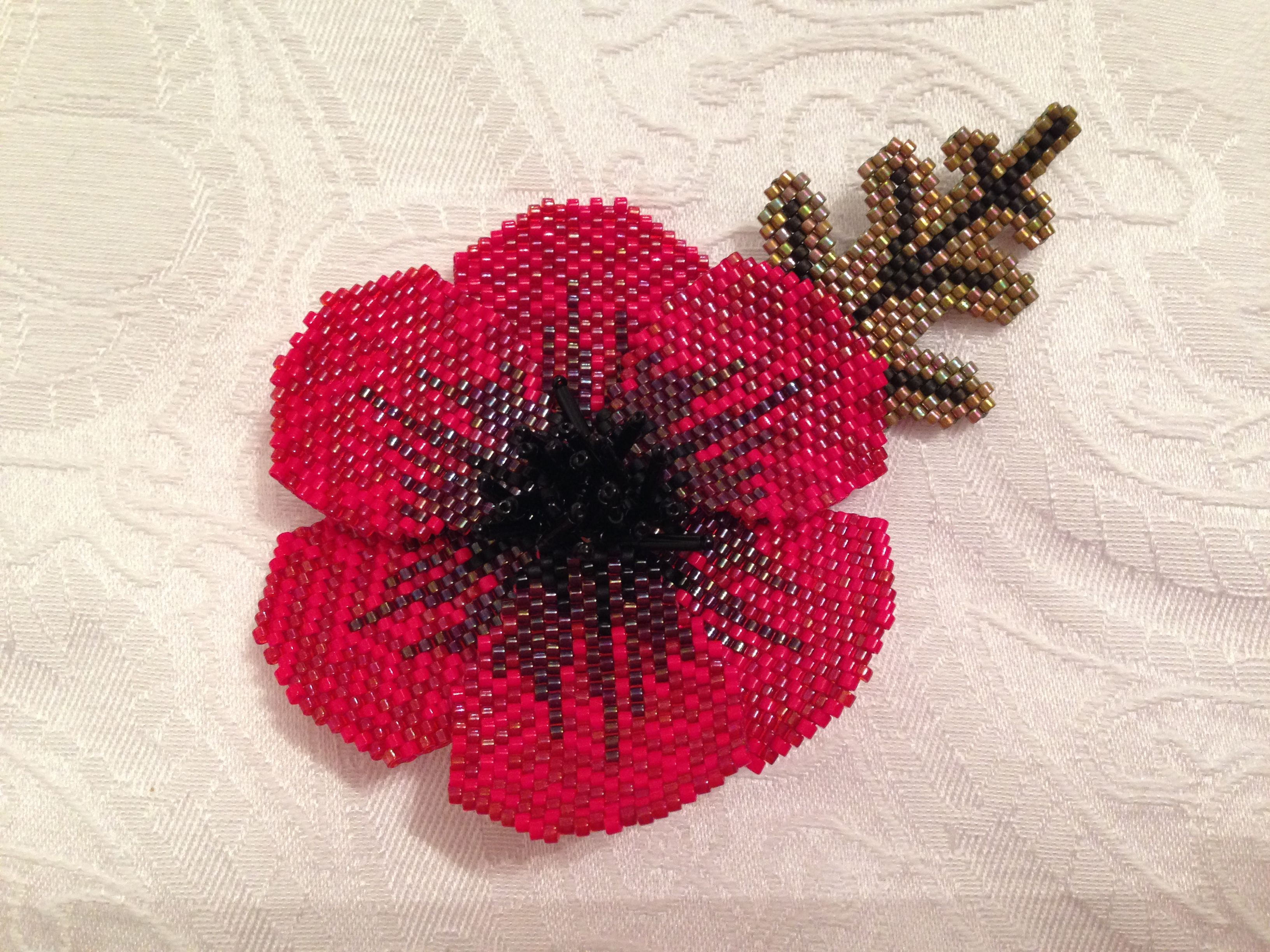 handmade beaded poppy made for remembrance day made using a