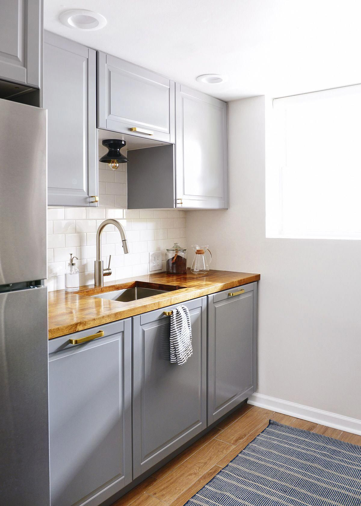 An IKEA galley kitchen by Yellow Brick Home -- #sponsor, gray cabinets, butcher block counters, gray cabinetry in kitchen, small kitchen ideas, galley kitchen ideas #kitchenideas #traditionalkitchen #ikeagalleykitchen