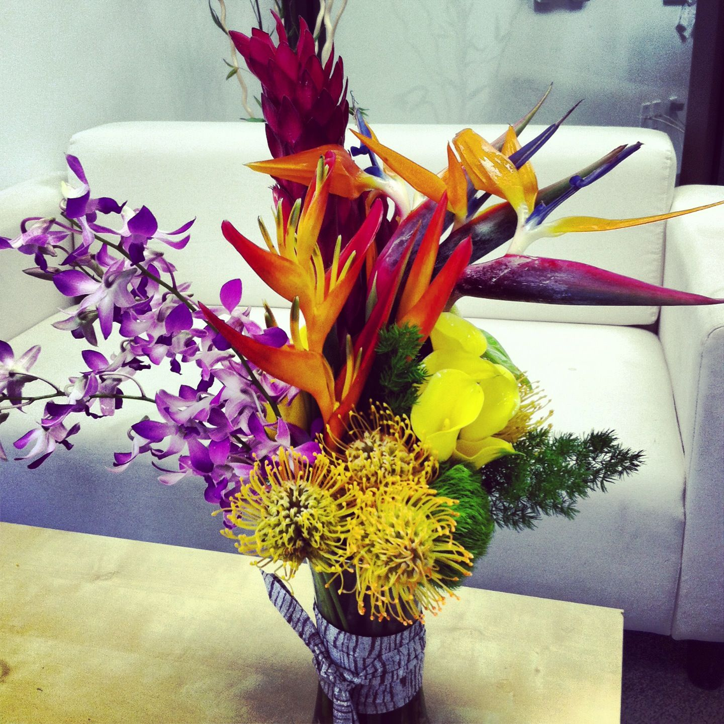 Bird of paradise heliconia protea orchids and calla