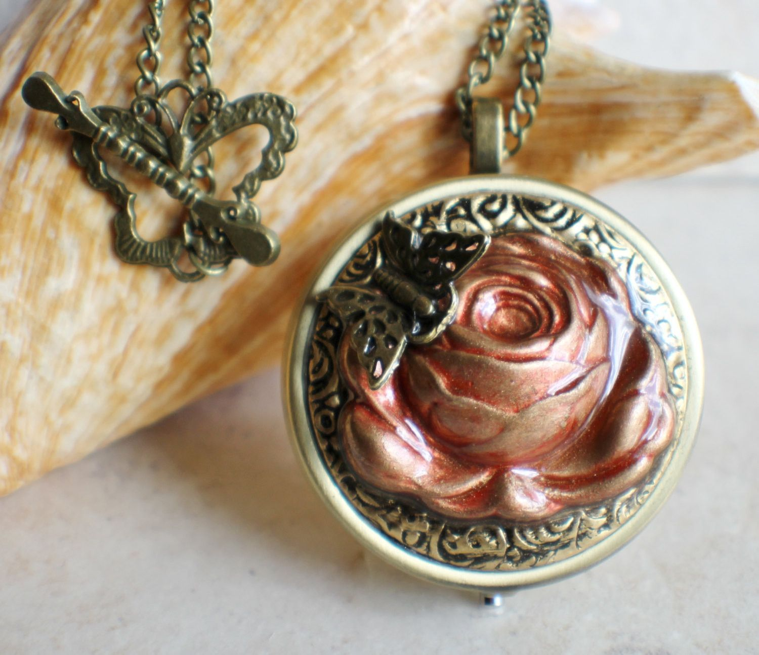Music box pendant this round music box pendant is inspired by the music box pendant this round music box pendant is inspired by the gorgeous music box pendants of eras gone by music box is pill box size please look at aloadofball Images