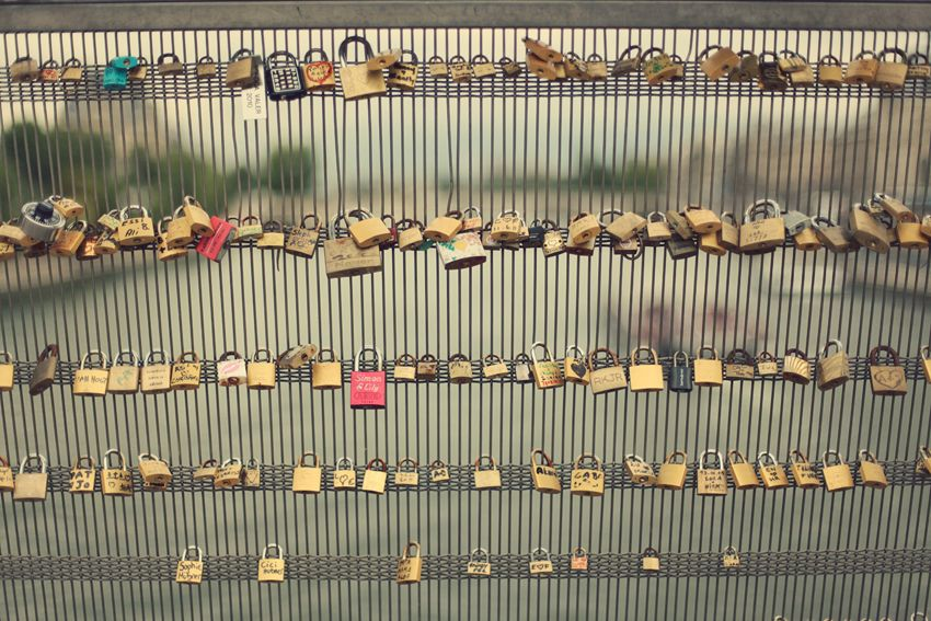 Lover's Lock Bridge In Paris, France. You take a lock and carve or write your initials along with your lover's initials on a lock and attach it to the bridge, then throw the key in the river. =]
