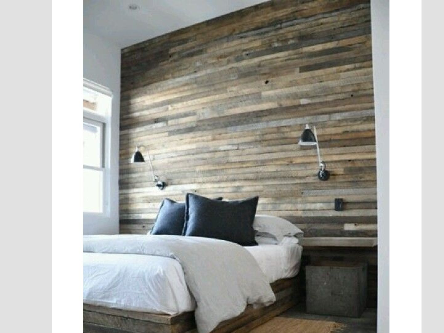 Low profile bed with wall paneling behind bed wall.  Home bedroom