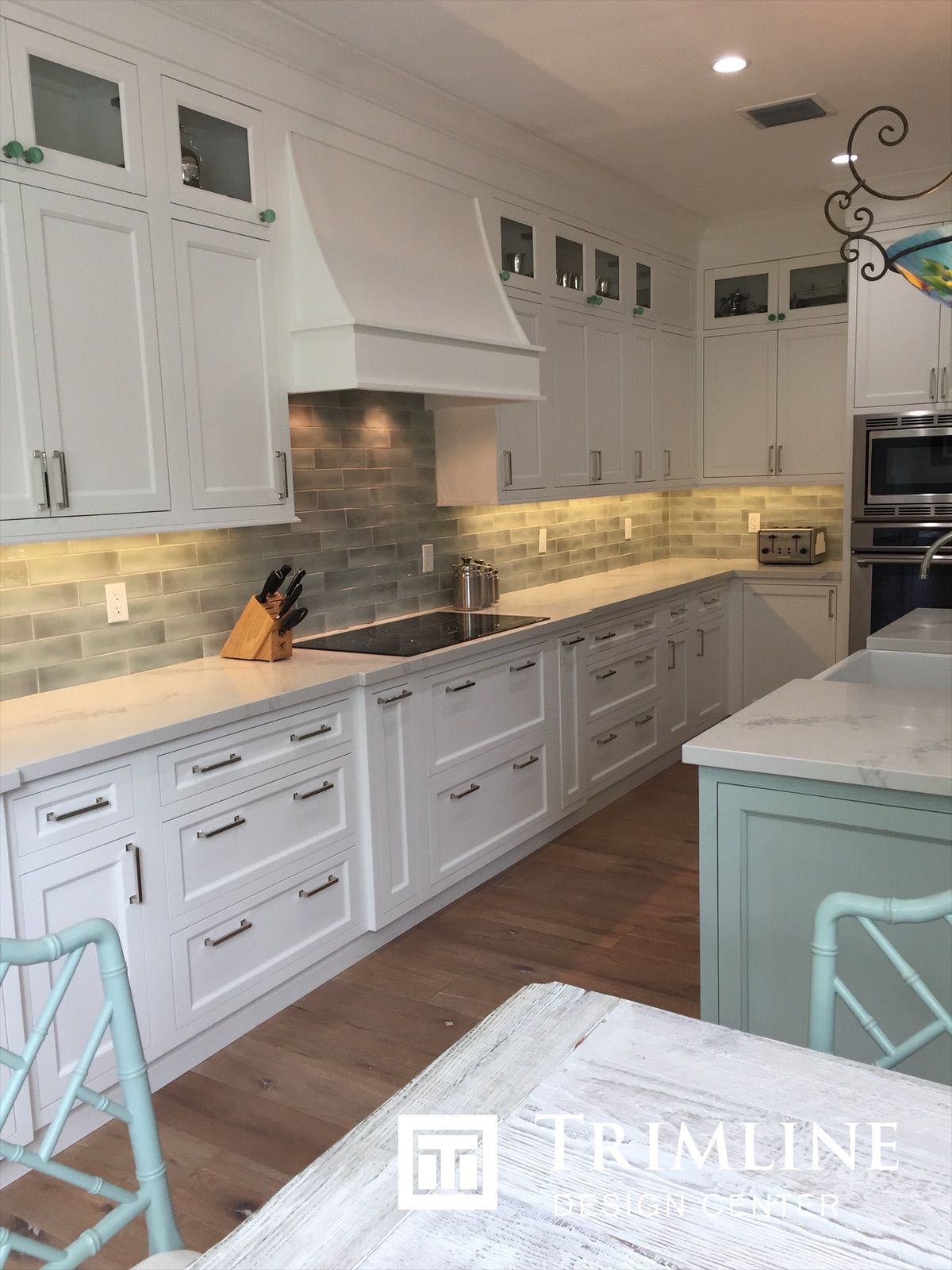 White Painted Cabinets Surrounded By A Celery Green Island Paint Cabinets White Painting Cabinets White Kitchen
