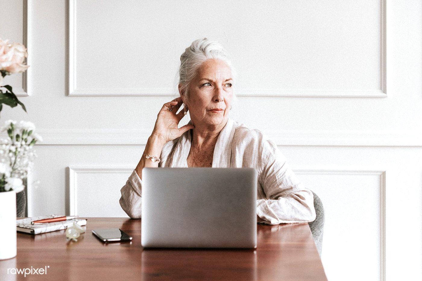 Download Premium Photo Of Senior Businesswoman Using A Laptop