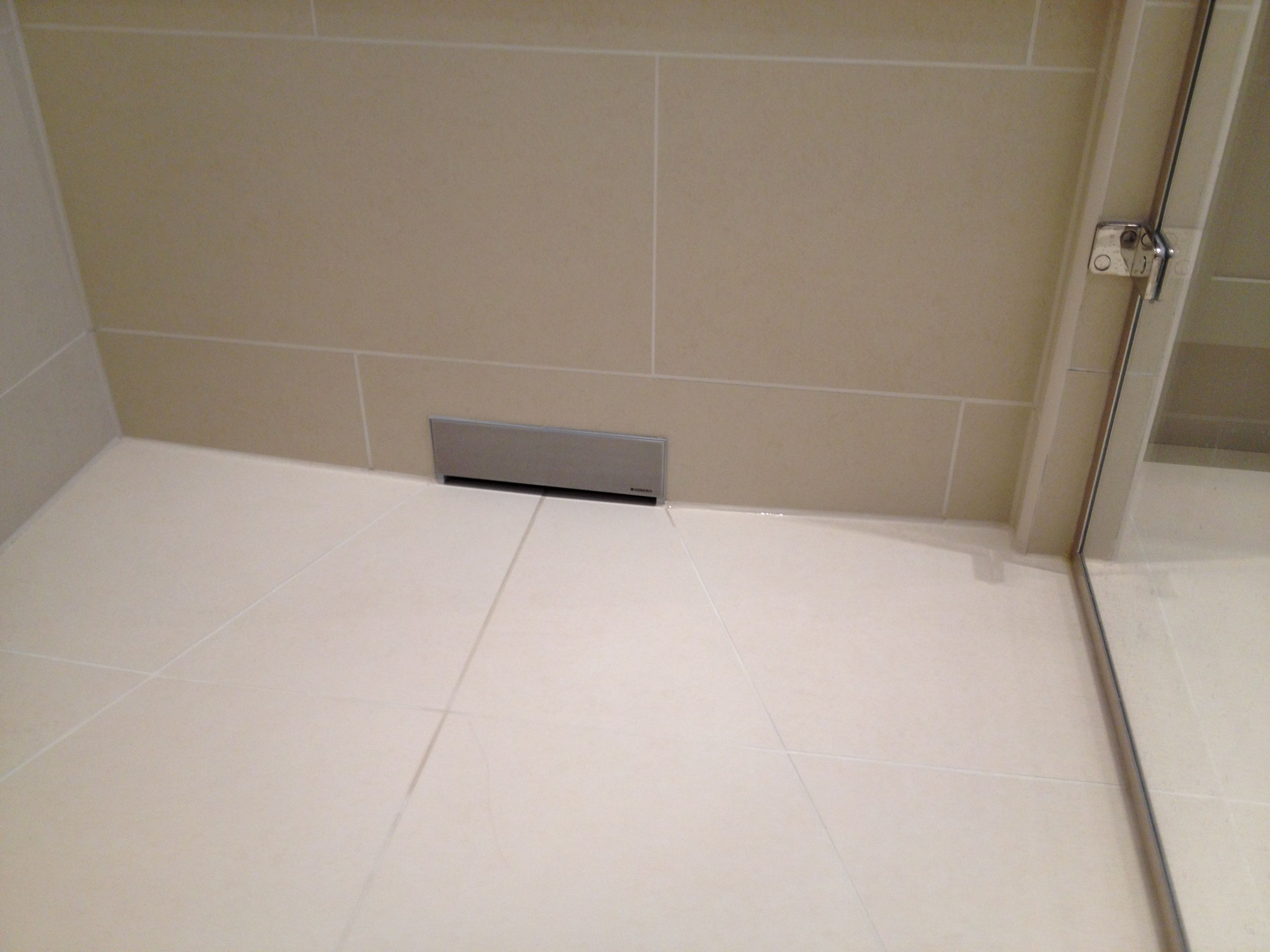Wet floor shower using geberit in wall drain on the for Geberit drains