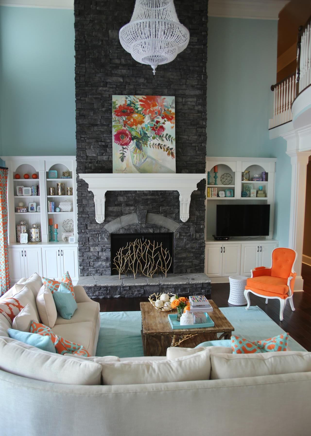 orange and aqua blue coastal living room | fireplaces, coastal
