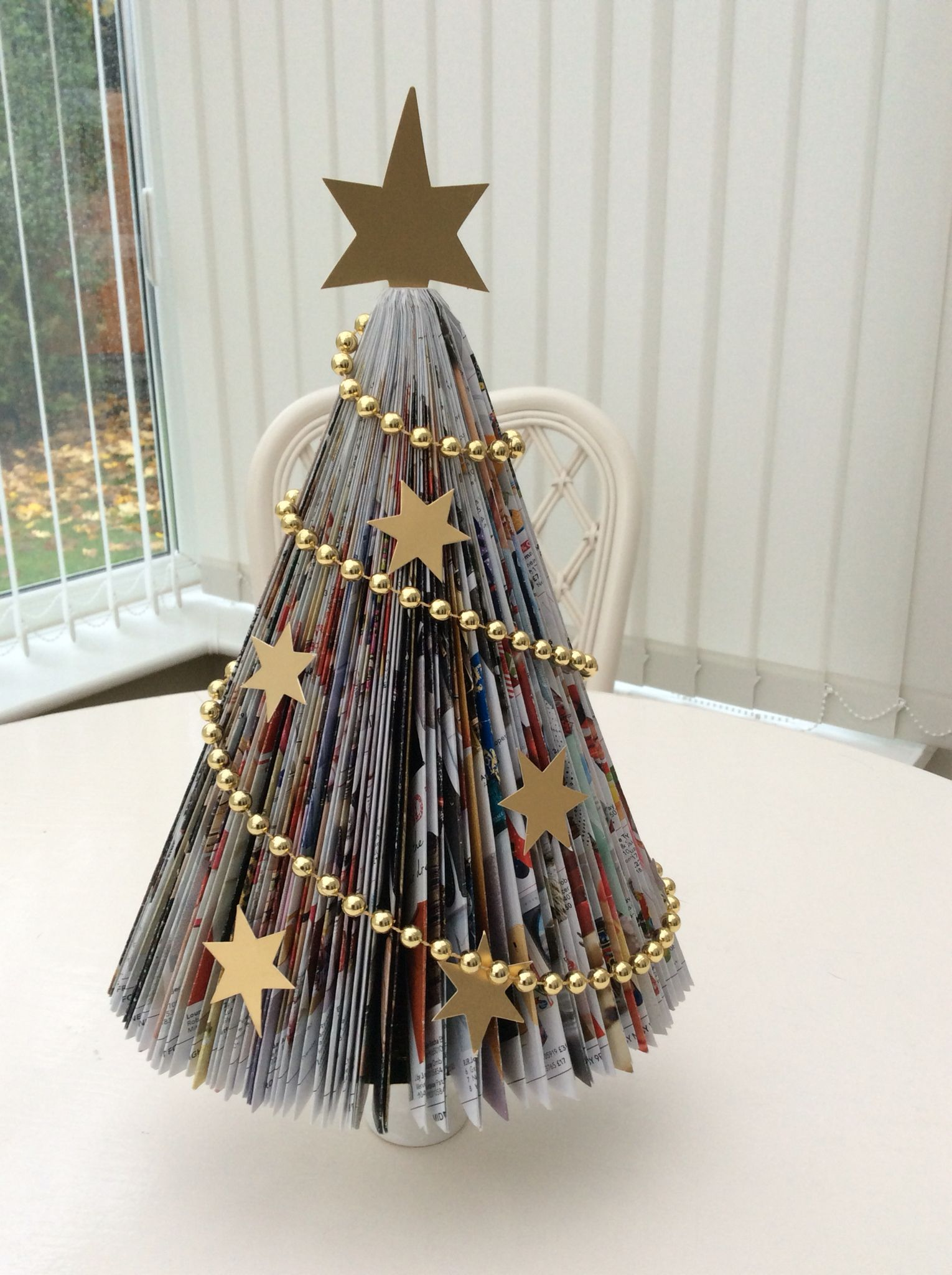 Book Folding Christmas Tree Using A Magazine Diy Christmas Deco Book Christmas Tree Christmas Centerpieces