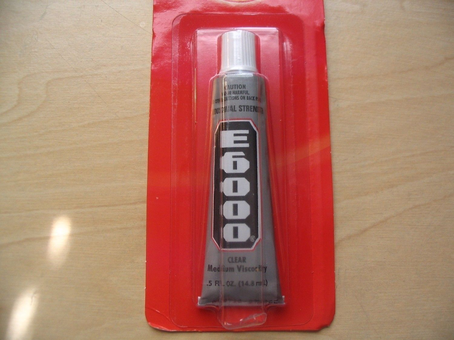 E6000 Adhesive 1/2 oz tube. Great for adhering magnets, bails, securing tiles or cabochons in the pendant trays, and much more!