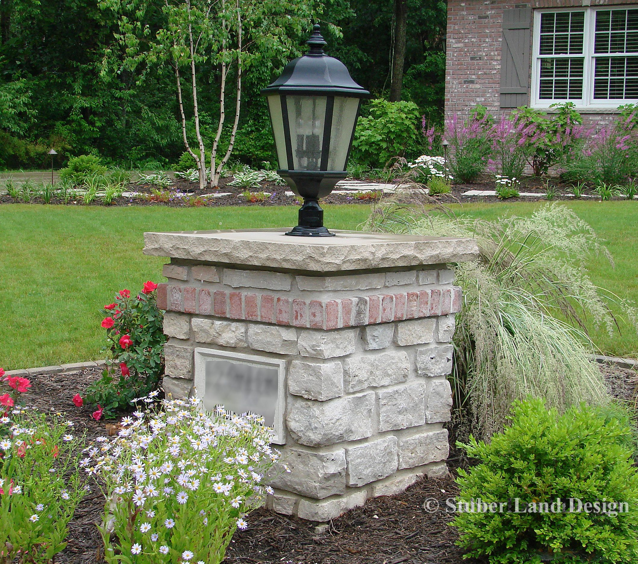 16 Enchanting Modern Entrance Designs That Boost The: Mortared Natural Stone Pillar With Landscape Lighting And