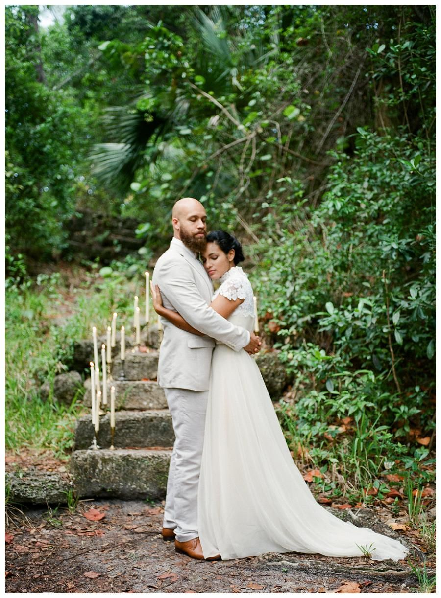 Romantic bride and groom. Bride's dress from Gossamer. Photographed by Denice Lachapelle at Greynolds Park in North Miami Beach, FL.