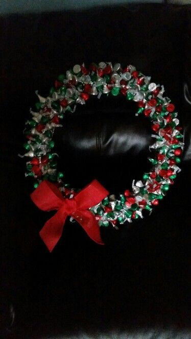 Easy to make Hershey kisses wreath. Just need a styrofoam circle wreath cover in foil break pointed tooth picks in half and stab through kisses and then wreath. Simple and cute.