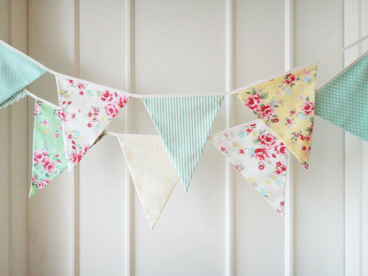 I really like this type of fabric bunting.  I'd like to use it on the chairs down the aisle and on the front of the bar and buffet/gift/sweetheart table at the reception.  I'll use 4 or 5 different fabrics in purples/blues/pinks.