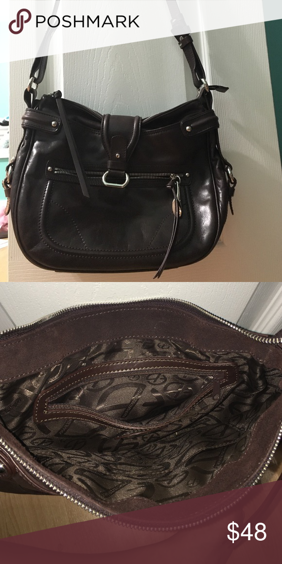 Brown Francesco biasia purse Brown with silver hard wear. Looks like it is in perfect condition. Leather Francesco Biasia Bags Crossbody Bags