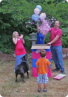gender reveal party idea black balloon filled with colored tissue