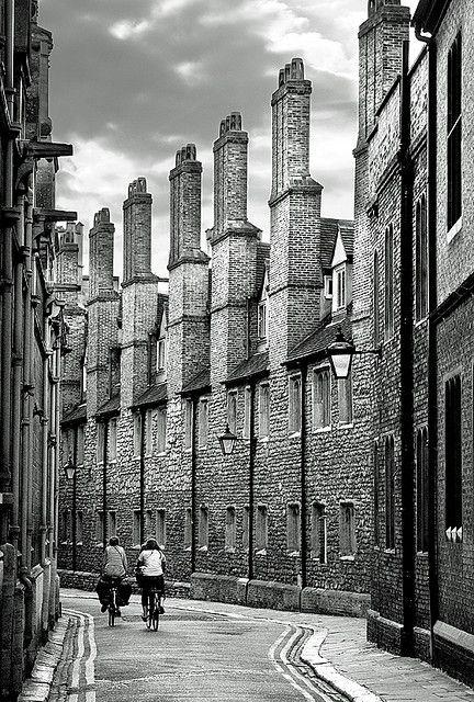 Cambridge   England. Cycling through the streets.  http://www.lonelyplanet.com/england/eastern-england/cambridge