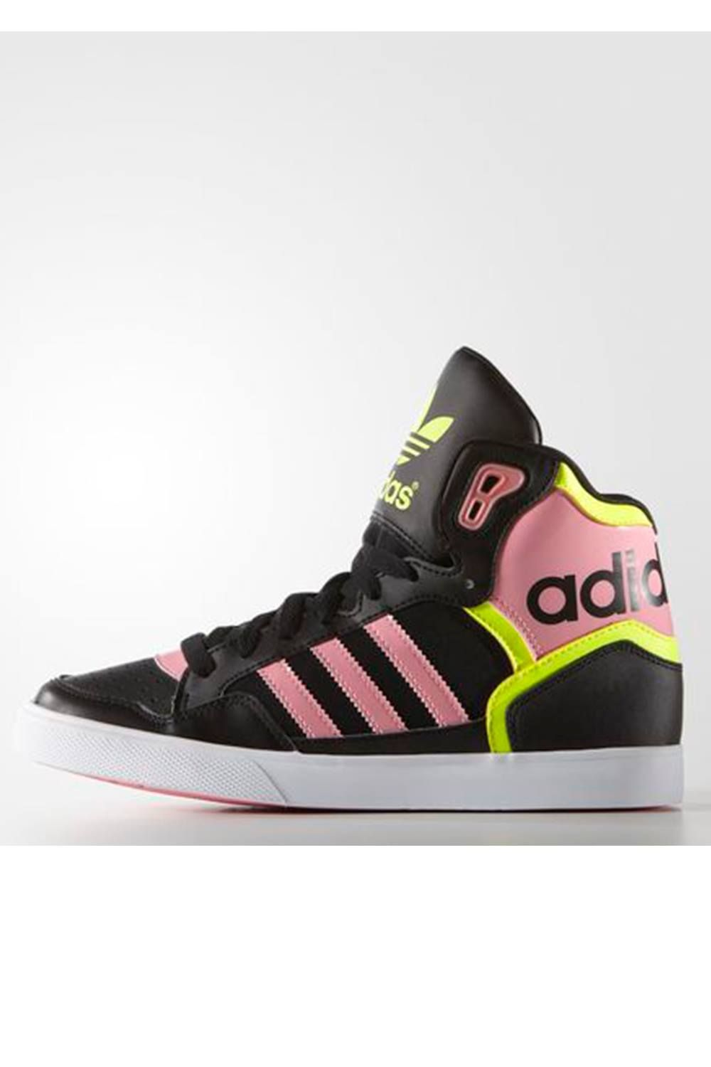 This archival basketball shoe style still knows how to have fun. The  women's Extaball shoes show off shiny patent an oversize tongue and a big  adidas logo ...