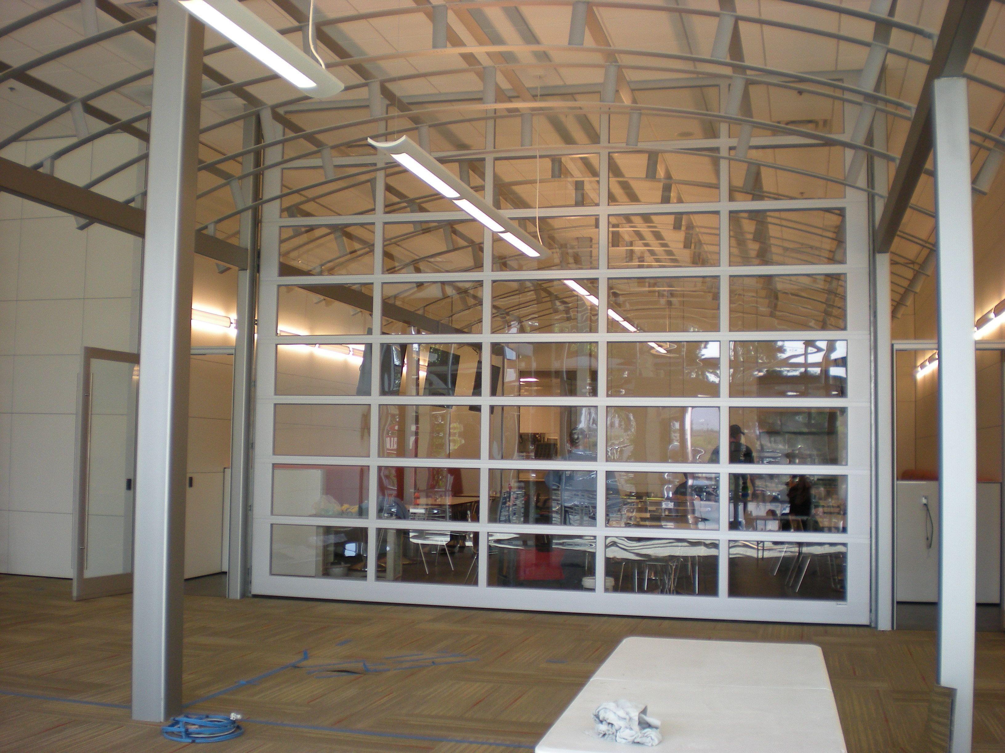 Glass overhead doors - 16 Glass Overhead Door And Aluminum Barrel Vault System