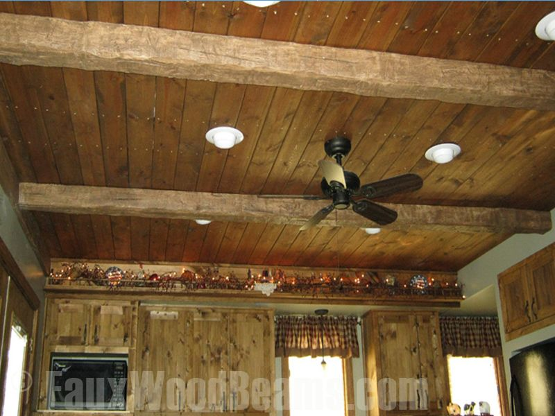 Wood ceiling planks conjoined with faux ceiling beams to create a .
