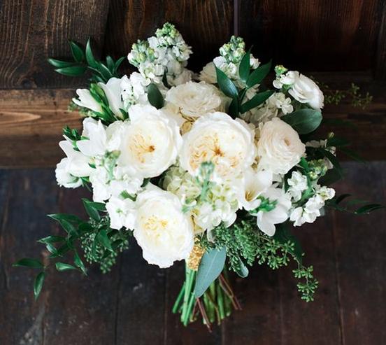 the bride will carry a slightly asymmetrical bouquet of cream hydrangeas ivory garden roses