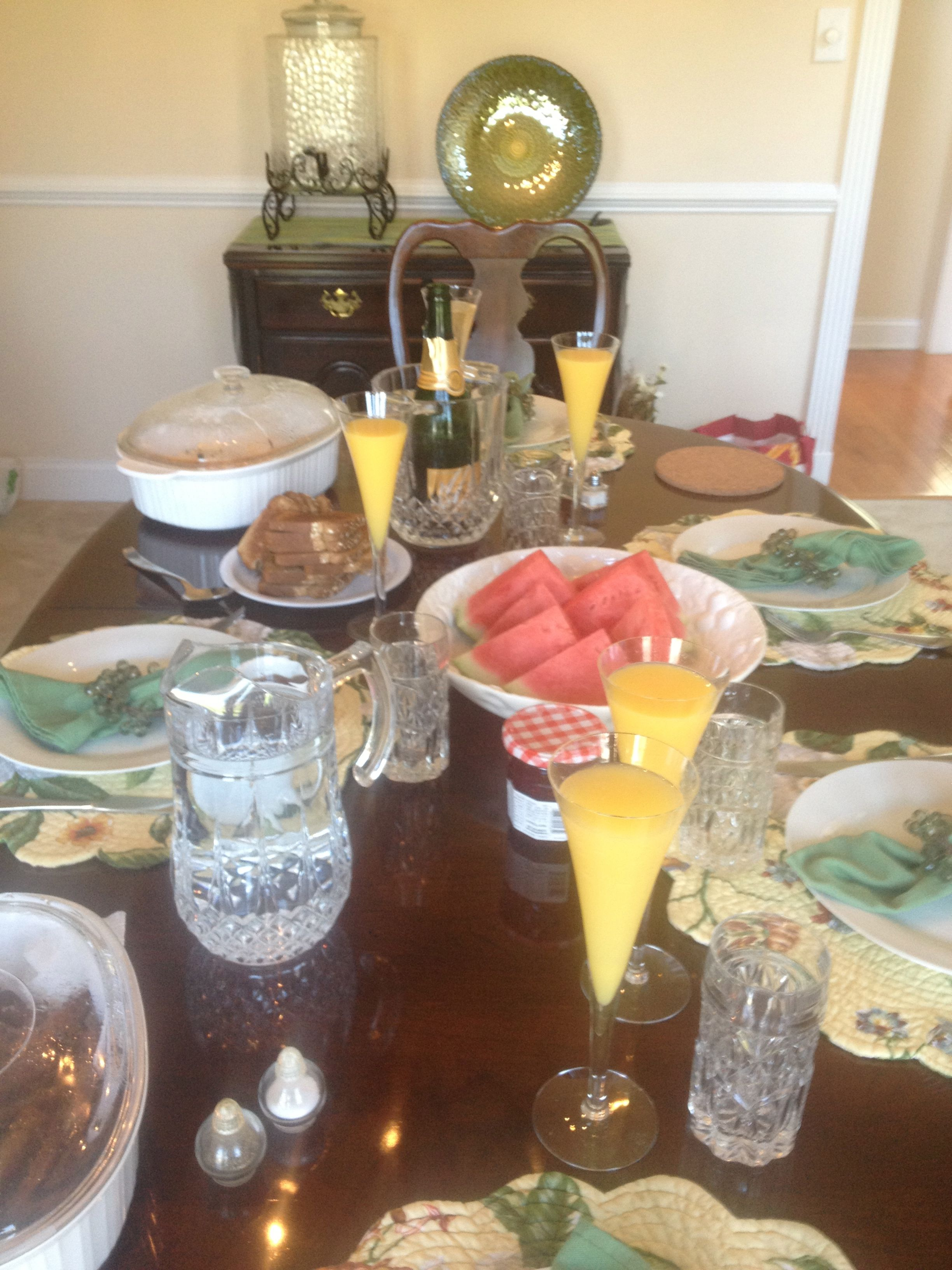 Sunday brunch on a hot summer morning. Fresh Mimosas and watermelon, french eggs and whole grain toast. Pork roast for good measure