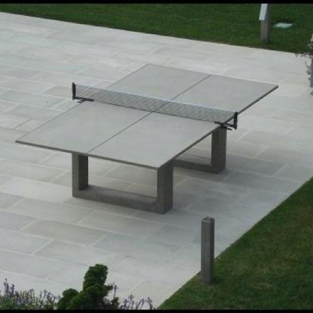 concrete ping pong table that doubles as an outdoor dining table perfect for our backyard