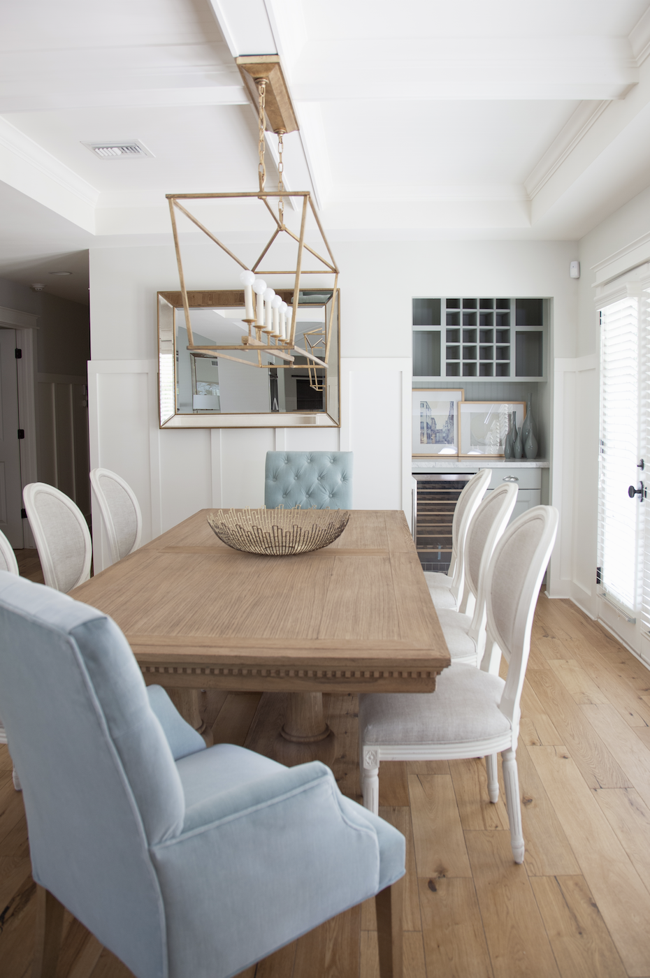 54th PL Residence Transitional Dining Room With Alternating Style Chairs  Upholstered In Neutral Colored Fabrics Accented