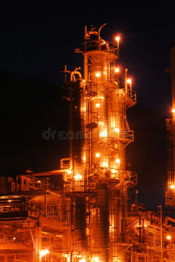 Oil Refinery at Night A column in an oil refinery in operation with columns ta