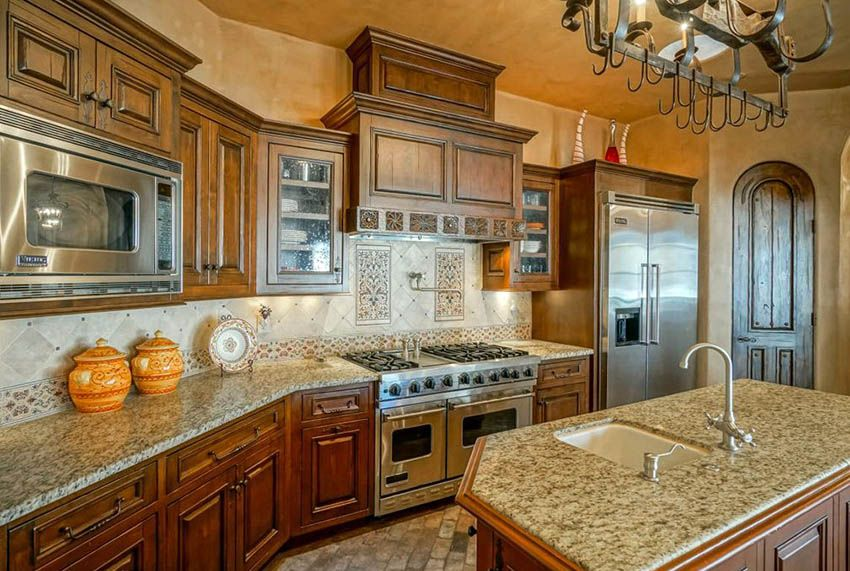Spanish Chefs Kitchen With Decorative Tile Backsplash Viking Liances And Granite Countertops