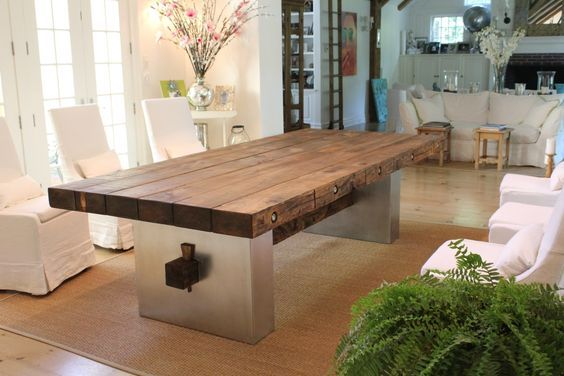 A metal base gives this rustic barnwood table and upscale and ...