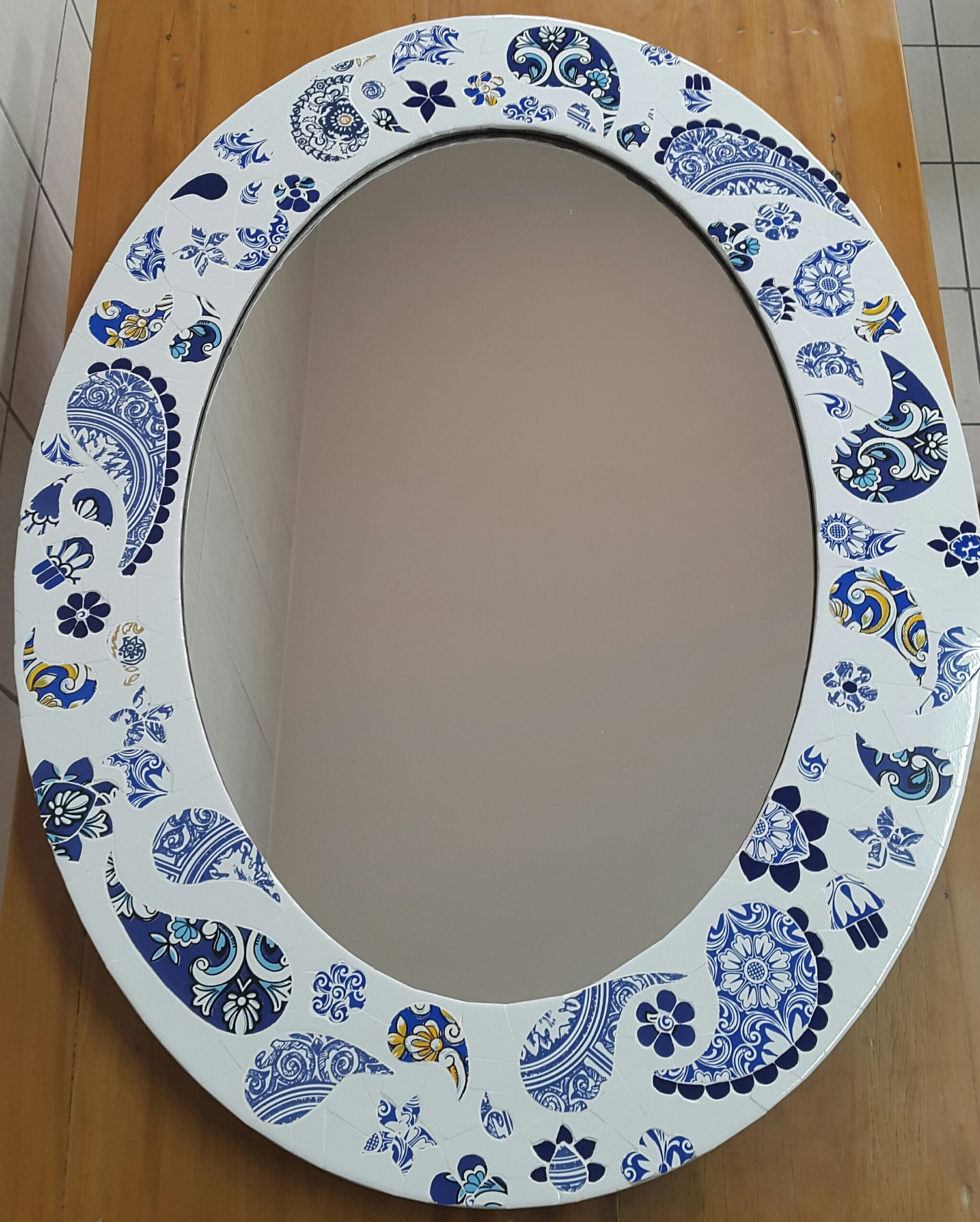 Mosaic mirror - paisley in blue and white tiles.