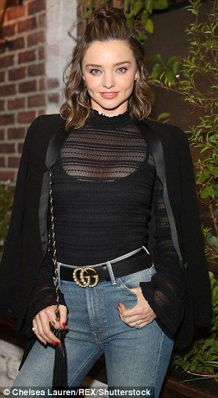 c181acd4b Optimal pairing: The gorgeous Australian paired the light cropped jeans  with a Gucci belt and a sheer long-sleeved top with a black tank underneath