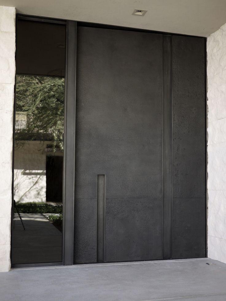 modern exterior oversized pivot door at pivotdoorcompany