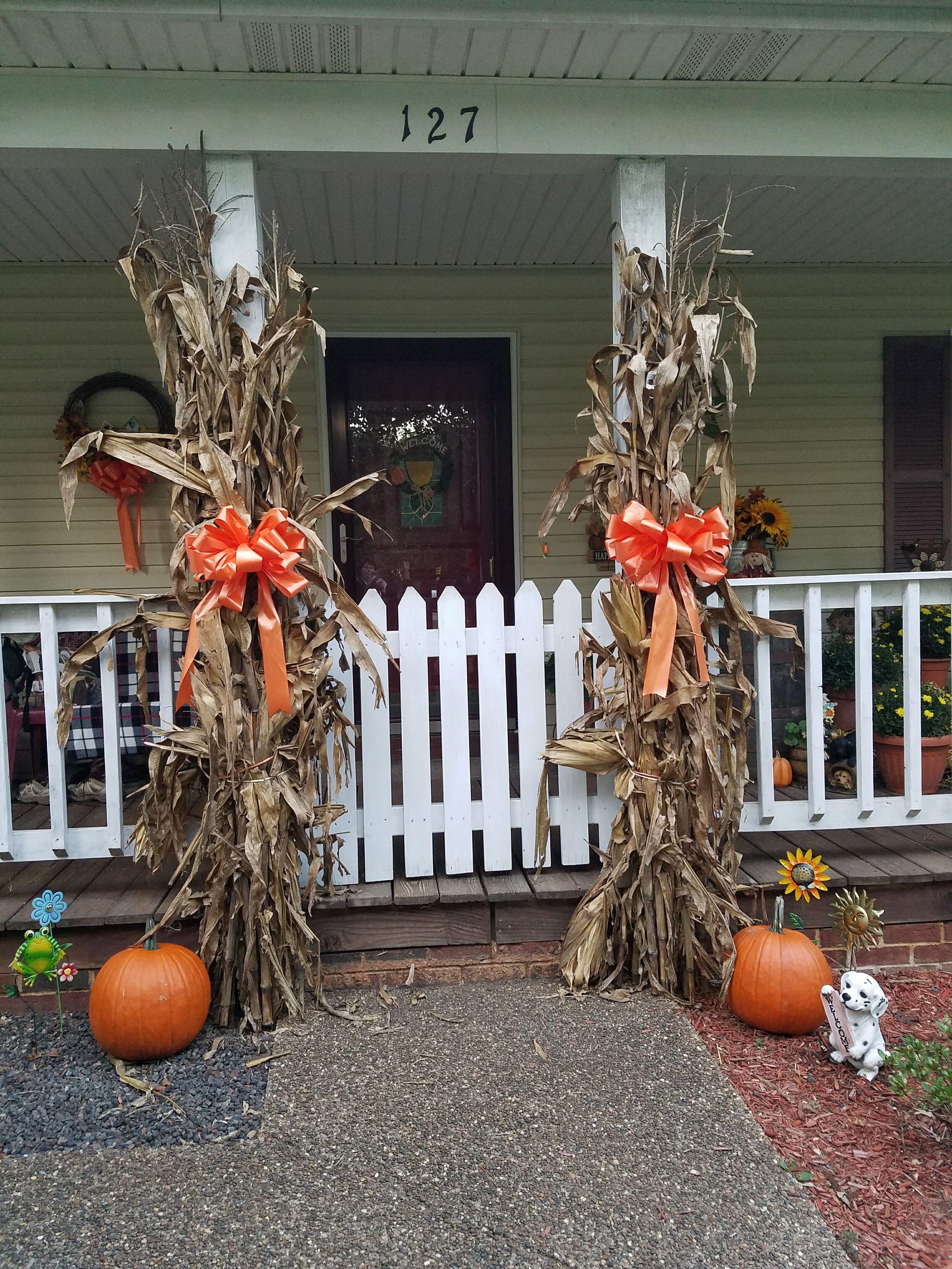 Cornstalks and pumpkins on our front porch 2016 #fallfrontporchdecor
