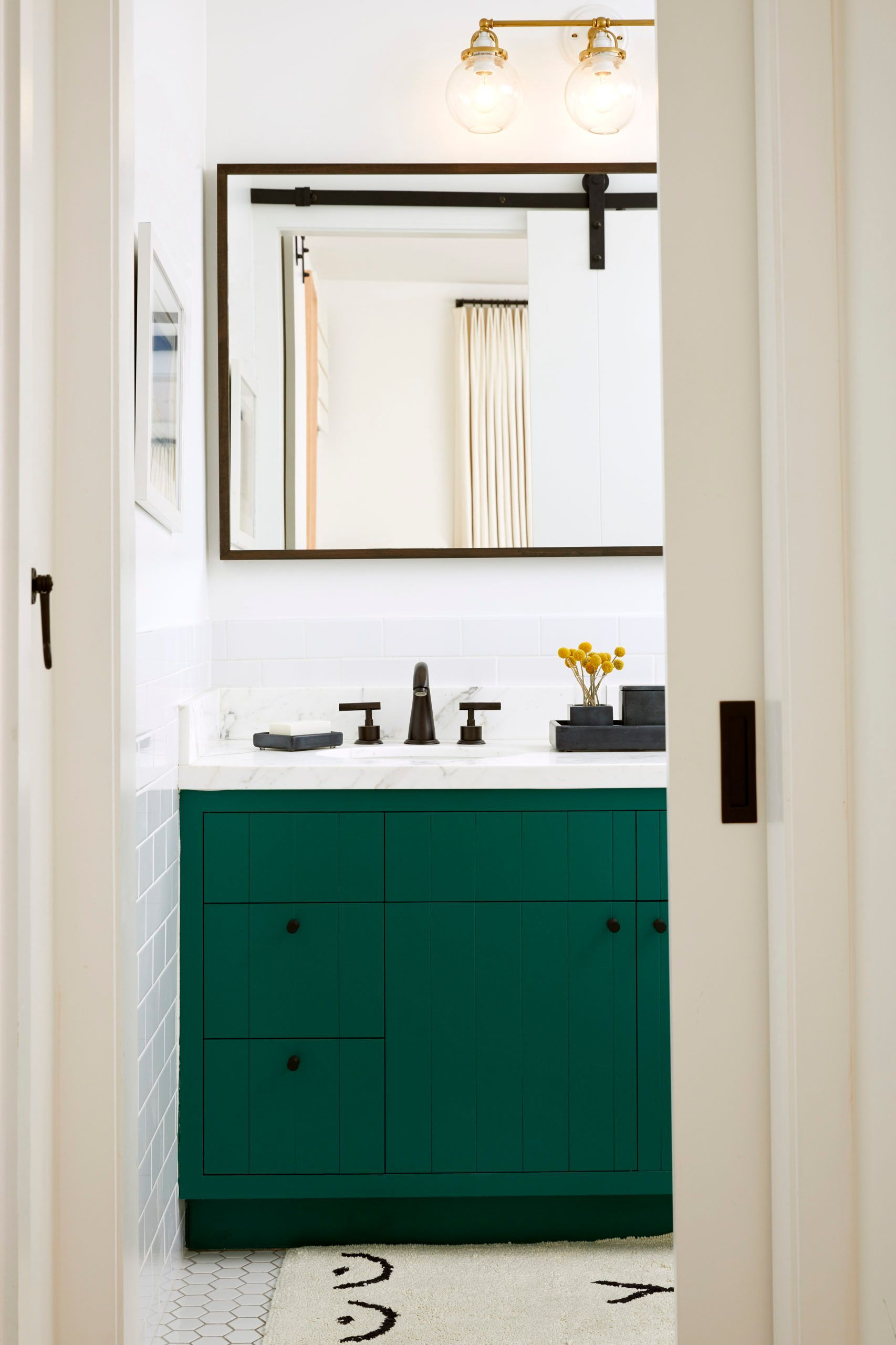 Home Tour Tile And Wallpaper Give A Cottage Modern Spanish Style Green Bathroom Dark Green Bathrooms Green Vanity [ 2560 x 1706 Pixel ]