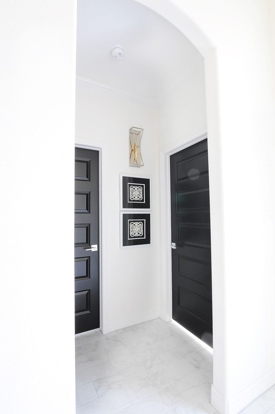 Tricorn Black Interior Doors In An Arched Hallway With White Trim And Alabaster Walls In A Modern Hom Black Interior Doors Doors Interior Doors Interior Modern