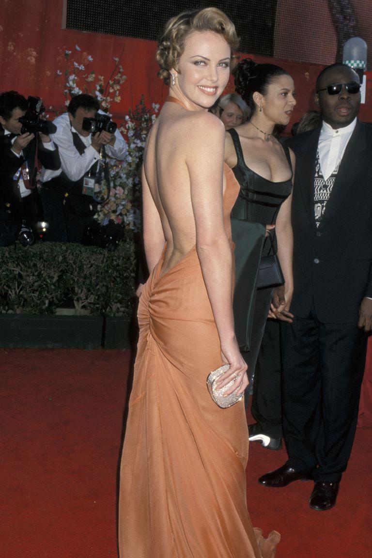 d76b997b8c3 The Sexiest Oscars Dresses of All Time   Charlize theron   Oscar ...