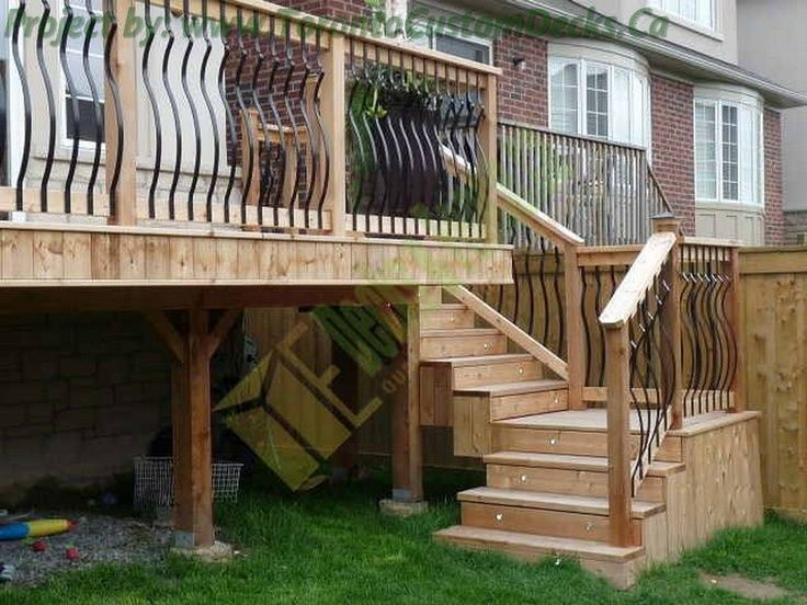 Patios On A Slope | Like the spindles instead of wooden ones.