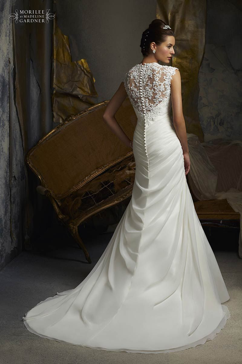 Chiffon draped wedding dress with cap sleeves and full lace back