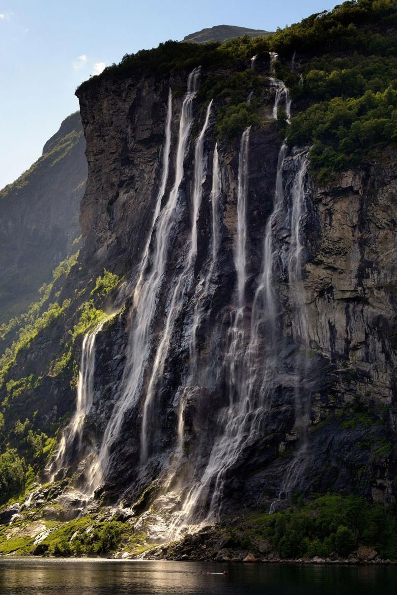 Seven Sisters Waterfall In Geirangerfjord Known As The Real Jewel Of The Norwegian Fjords Listed On The Unesco World Road Trip Usa Scenic Waterfall Waterfall
