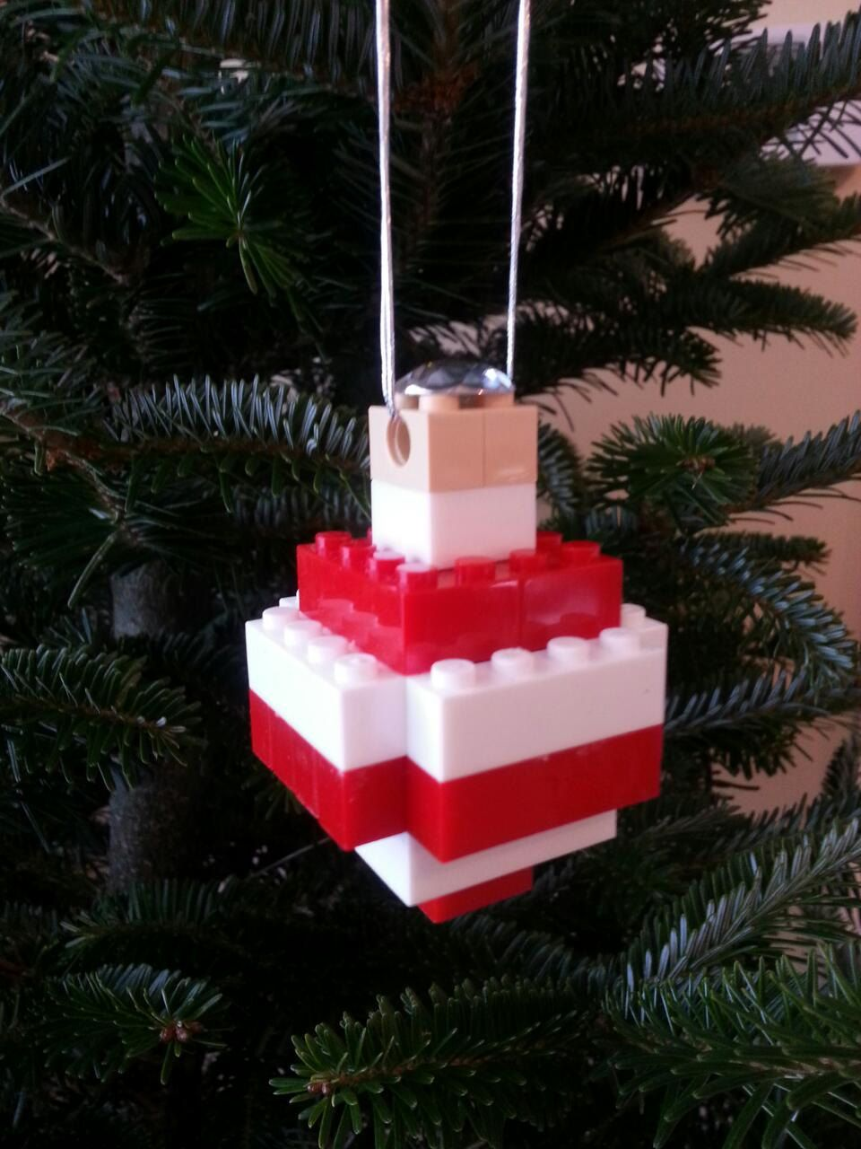Tree ornament using legolike building blocks in red and white by