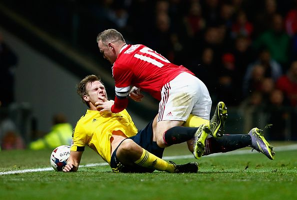 Wayne Rooney of Manchester United goes to ground with Tomas Kalas of Middlesbrough during the Capital One Cup Fourth Round match between Manchester...