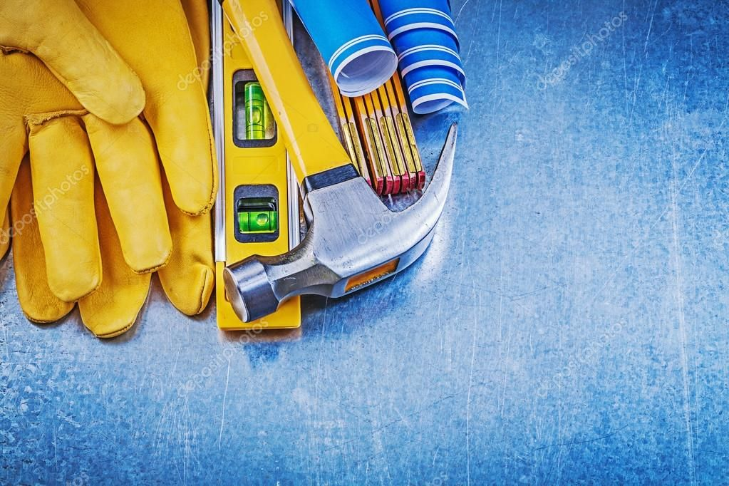 Safety gloves, hammer and construction level Stock Photo