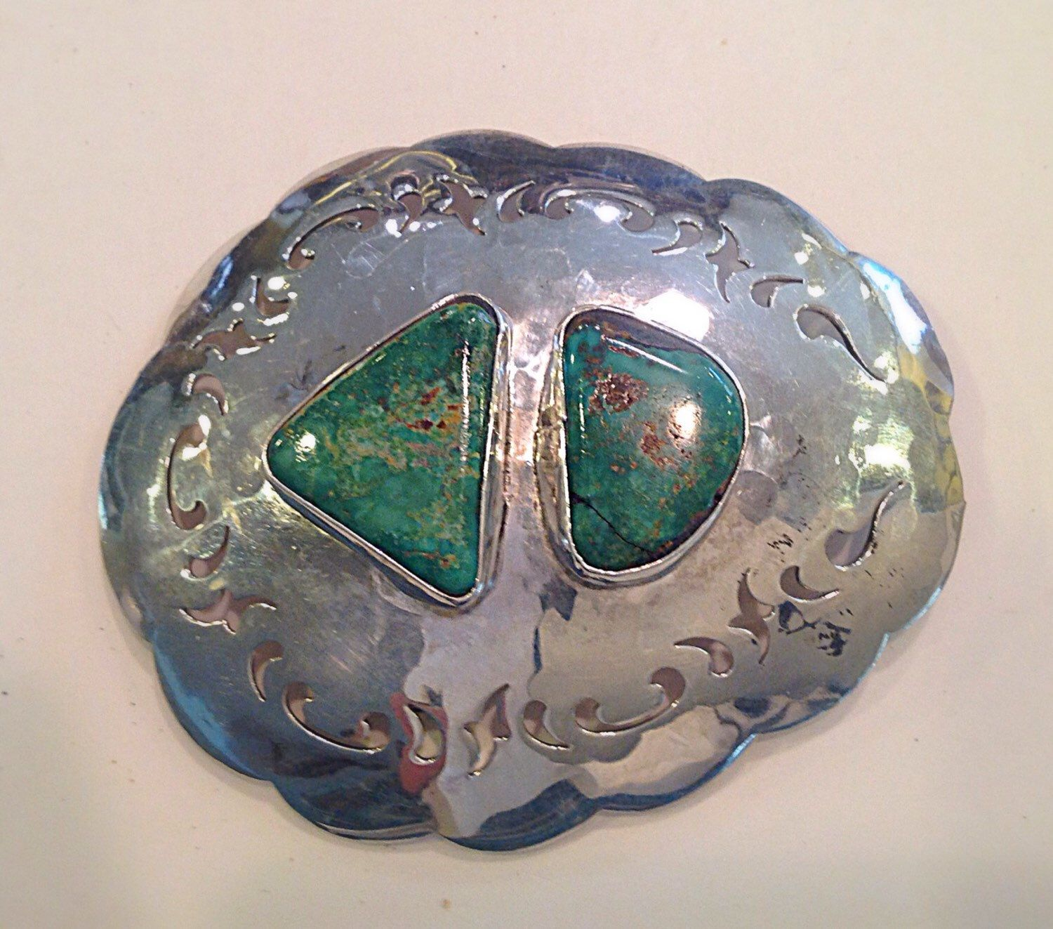 A personal favorite from my Etsy shop https://www.etsy.com/listing/226004517/a-sterling-silver-turquoise-belt-buckle