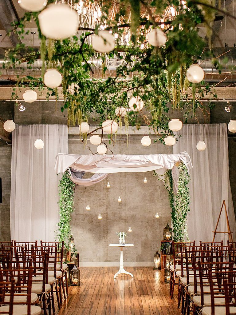 Blend the aisle into the ceremony space by using the same inspiration in your wedding arch