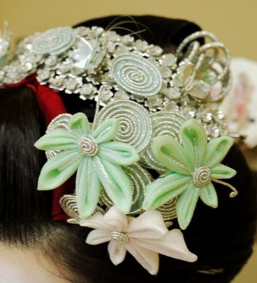 This is from a maiko henshin studio, but it could be a previous year's real maiko kanzashi (I don't know, but I assume that because there are so many, some might end up with the henshin studios)  I love the spirals
