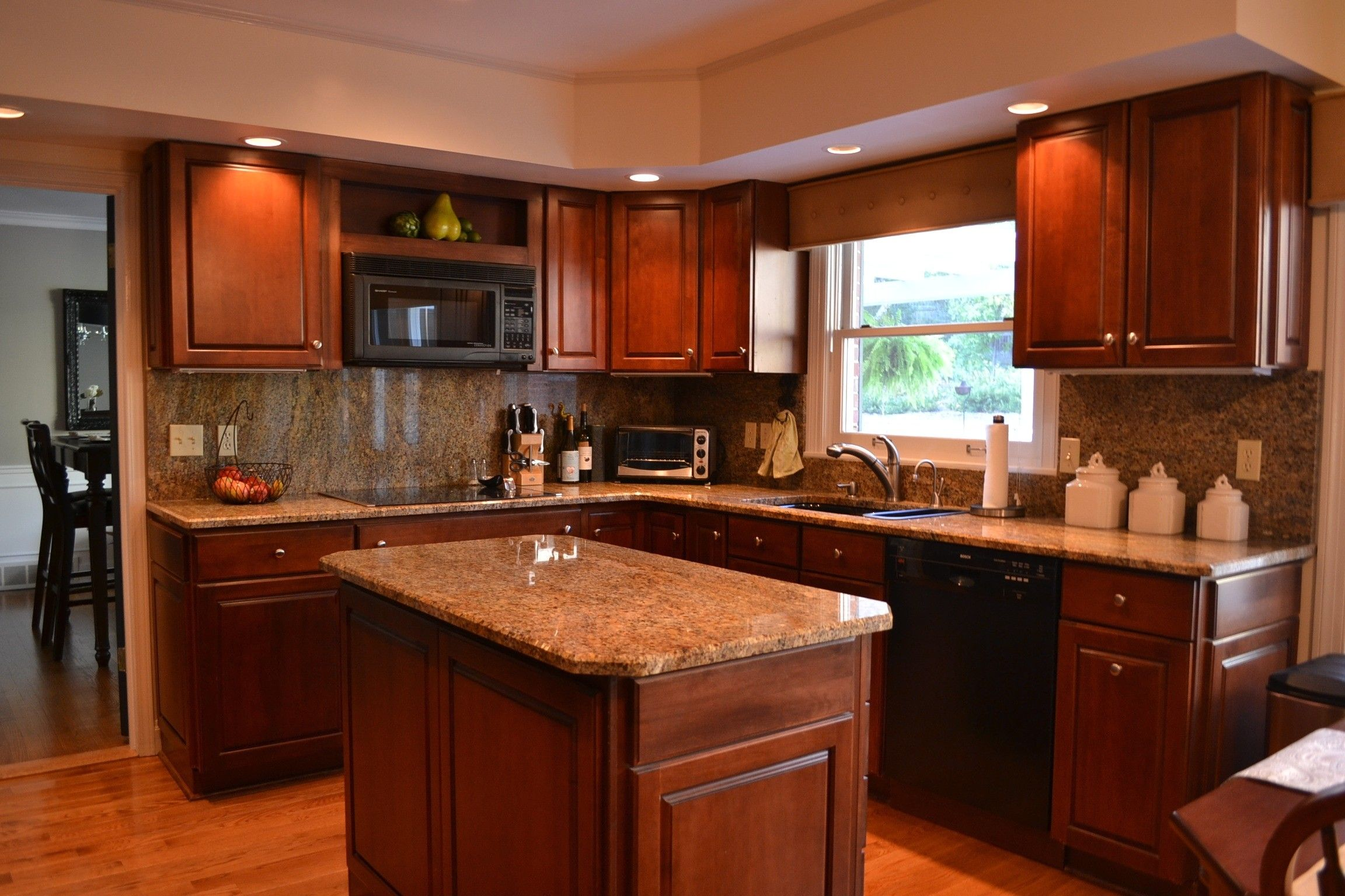 Red Cherry Rope Cabinets With Decorative End Doors And Typhoon Bordeaux Granite Cherry Wood Kitchen Cabinets Kitchen Cabinet Design Cherry Cabinets Kitchen